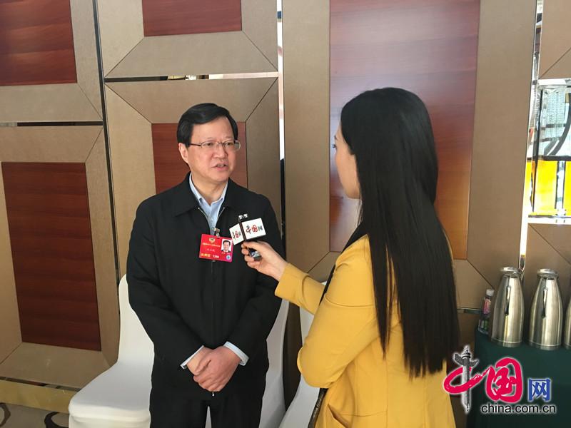國家糧食局長任正曉:中國人飯碗要端在自己手裏 讓農民有好收入(中國網記者 王金梅)